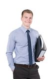 Молодой усмехаясь человек с файлом стоковая фотография