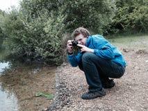 Молодой фотограф Стоковые Изображения