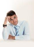 Молодой хороший смотря бизнесмен думая, задумчивый и сомнительный Стоковые Изображения RF