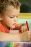 Молодой чертеж мальчика Стоковые Изображения
