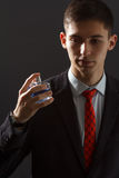 Молодой человек в костюме держа дух человека в его руке Стоковое фото RF