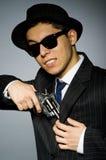 Молодой человек в классике striped костюм держа оружие Стоковые Изображения RF