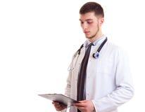 Молодой человек в мантии доктора Стоковая Фотография RF