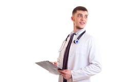 Молодой человек в мантии доктора Стоковые Фотографии RF