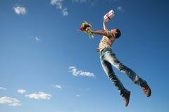 Молодой человек в небе Стоковое Фото