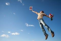 Молодой человек в небе Стоковое фото RF