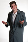Молодой человек в пальто шанца стоковые фотографии rf