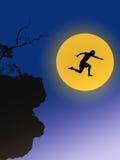 Молодой человек в силуэте скачет на цифровую смесь большой луны Стоковое Фото