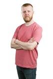 Молодой человек в футболке и джинсах стоковые изображения