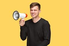 Молодой человек держа мегафон Стоковое Изображение