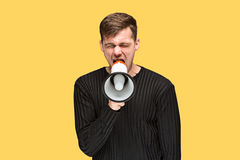 Молодой человек держа мегафон Стоковая Фотография