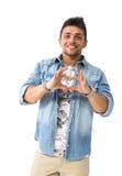 Молодой человек делая знак сердца с его руками Стоковые Изображения RF