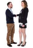 Молодой человек и привлекательная женщина тряся руки Стоковое Фото