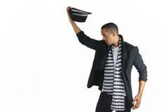 Молодой человек принимая его верхнюю шляпу Стоковое Фото