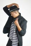 Молодой человек принимая его верхнюю шляпу Стоковые Фото