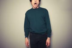 Молодой человек с его ртом открытым стоковые изображения rf