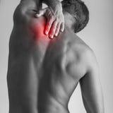 Молодой человек с красным пятном backache Стоковое фото RF