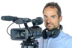 Молодой человек с профессиональным киносъемочным аппаратом Стоковое фото RF