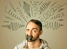 Молодой человек с склеенным ртом и курчавыми линиями Стоковые Фотографии RF