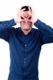 Молодой человек с смешным выражением Стоковые Фотографии RF