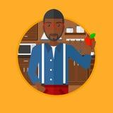 Молодой человек с яблоком в кухне Стоковое фото RF