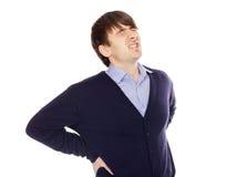 Молодой человек с backache изолированный на белизне Стоковая Фотография RF