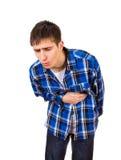 Молодой человек чувствует Stomachache Стоковые Фотографии RF