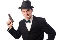 Молодой элегантный человек держа личное огнестрельное оружие изолированный дальше стоковые фотографии rf