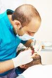 Молодые азиатские доктора дантиста на работе Стоковое Изображение RF