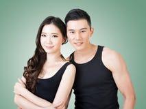 Молодые азиатские пары спорта стоковое фото