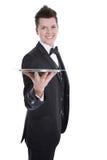 Молодые дворецкий или кельнер в черном костюме изолированном на белизне стоковые фотографии rf