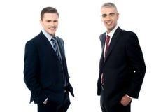 Молодые деловые партнеры изолированные на белизне стоковое фото rf