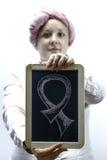 Молодые женщины одели в пинке, воюя снова рак молочной железы Стоковые Фото