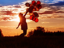 Молодые женщины с воздушными шарами Стоковая Фотография