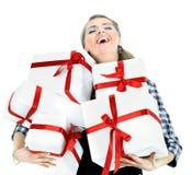 Молодые женщины с покупками на белой предпосылке Стоковые Фотографии RF