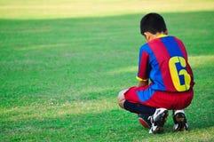 Молодые мальчики в футболе Стоковое Изображение RF