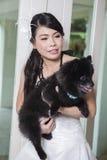 Молодые невеста и собака Стоковая Фотография RF