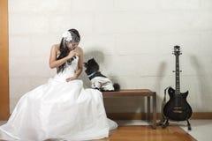 Молодые невеста и собака Стоковая Фотография