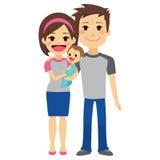 Молодые пары держа младенца Стоковые Изображения