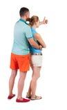 Молодые пары указывая на wal задний взгляд Стоковые Изображения RF