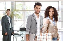 Молодые предприниматели покидая офис стоковые фотографии rf