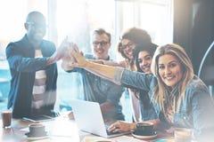 Молодые предприниматели празднуя новый проект Стоковое Фото