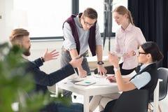 Молодые предприниматели работая совместно Стоковое Фото