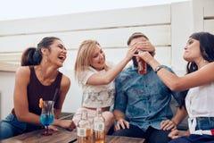 Молодые люди имея потеху на партии Стоковые Фотографии RF