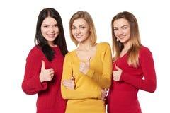 Молодые люди с большими пальцами руки вверх Стоковое Фото