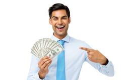 Молодым примечания доллара бизнесмена дуют показом, который вне Стоковая Фотография RF