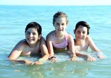 3 молодых брать в море в лете Стоковые Изображения RF