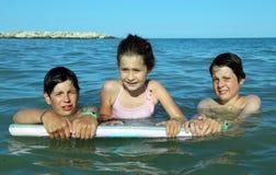 3 молодых брать в море в лете Стоковая Фотография RF