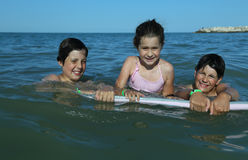 3 молодых брать в море в лете Стоковое фото RF