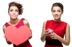 2 молодых жизнерадостных женщины в красном платье Стоковая Фотография RF